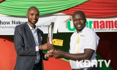 Username Investment Ltd. staff members holding the trophy won as for Best Stand in Real Estate Category at 2019 Nakuru National Agricultural Show