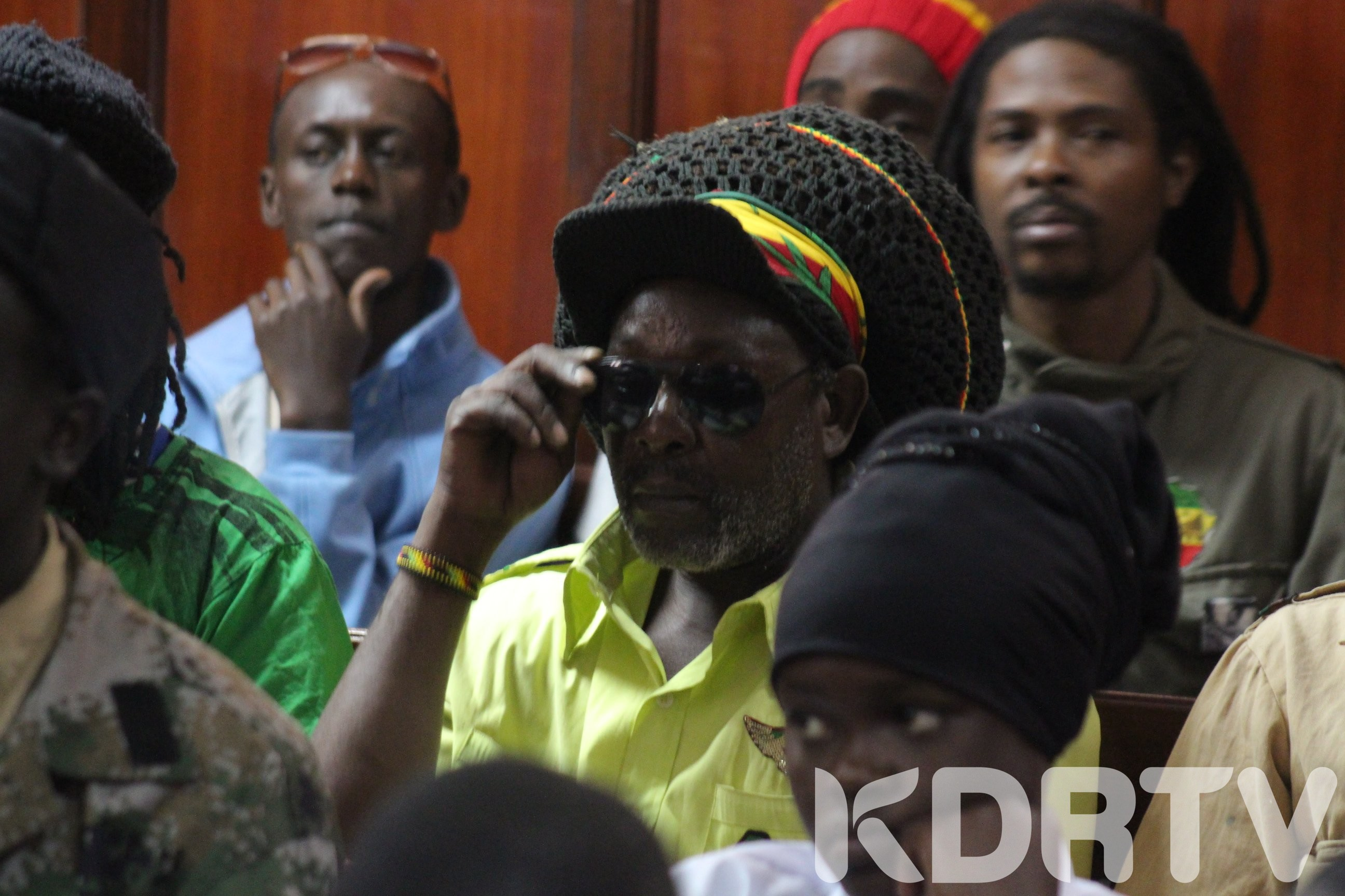 Family and members of the Rastafarian community during the ruling of the case involving a minor sent away from school due to dreadlocks. Picture from twitter.
