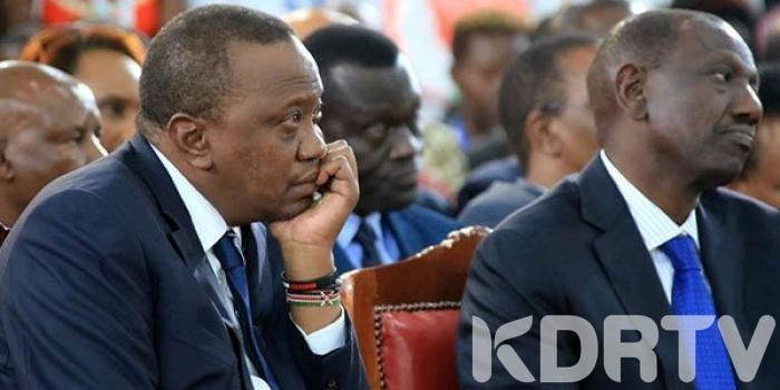 Uhuru and Ruto sad