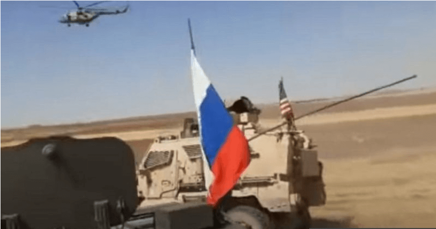 Russian millitary vehicle rams the US armoured vehicle