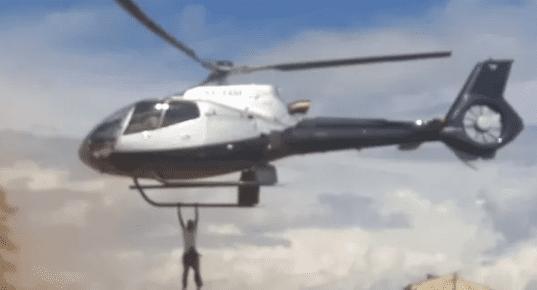 Sale Wanjala alias Kenyas James Bond hangs on a helicopter in 2016 during the funeral of businessman Jacob Juma. PhotoFile
