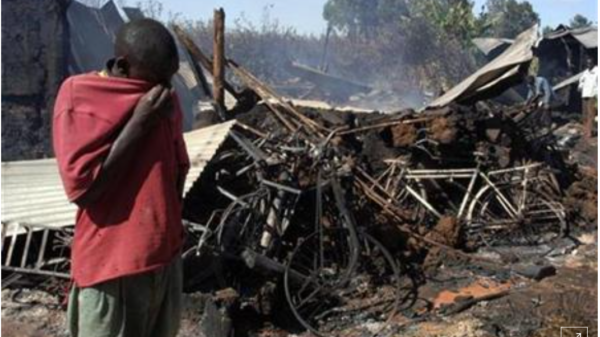 A man stands in front of the remains of the Kiambaa Church on January 2 2008
