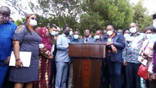 President Uhuru Kenyatta and ODM leader Raila Odinga with MPs in Naivasha